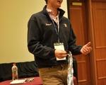 Andrew Campbell '14 talking award