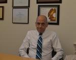 Meet Michael P. Burke, The Registrar