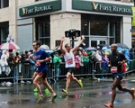 Runners Celebrate Near End of Marathon