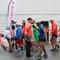 Runner Fistbumps Marathon Volunteer